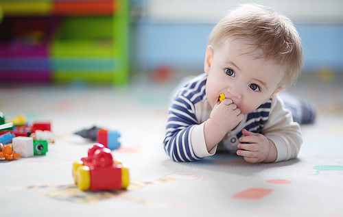 toddler kid playing with toys